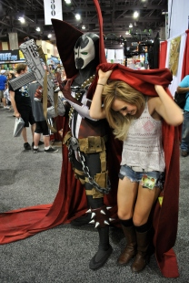 Jessica Nigri playing with Spawn's cape.