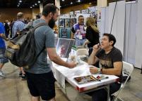 Paying compliments to Kubert again, autographed Wolverine #75.
